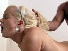 Alluring blonde screams like crazy with a huge dick up her shaved and tight vag