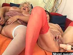 Huge natural juggs curvy mom has on a strap on penis to have lesbian bang with an younger lesbian woman