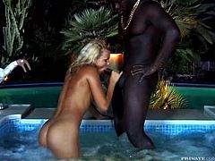 A very black dude is going to bang Sunny Blue, a very white blonde chick. The contrast is great and the interracial fun in the jacuzzi is hot!