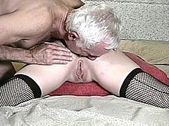 A salacious dark-haired milf wearing fishnet stockings is having fun with some white-haired guy. They have oral sex and then bang doggy style and in other positions and moan loudly.