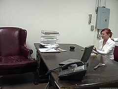 Naughty red haired secretary is about to give her boss steamy blowjob. She unbuttons her blouse and he starts to play with he juicy tits.