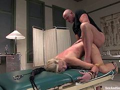 Samantha Sin the stunning girl in sexy nurse uniform gets bounded. Then she gives hot blowjob to the doctor and gets fucked from behind.