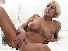 Devon Alexis with big hooters and shaved twat howls as she masturbates