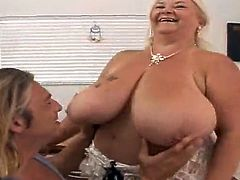 Tattooed granny Linda shows her pierced tits to some guy and lets him play with them. The man kneads and licks the melons and then fucks the bitch in missionary and other positions.