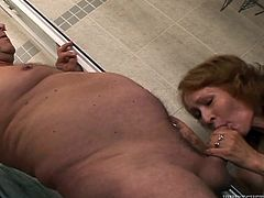 Lustful mature chick is taking a shower and giving blowjob to her husband. She is hot tempered momma who gives yum-yum blowjob.