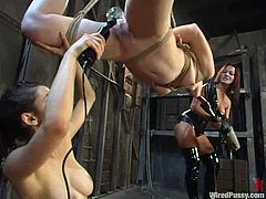 Justine Joli gets bound by Princess Donna Dolore and her assistant in a basement. Then the mistresses stuff Justine's holes with toys and torture the chick in many ways.