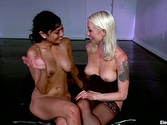There's some kinky electrical torture in this lesbian femdom video for Beretta James who will then lick Lorelei Lee's ass.