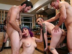 The cute redhead rubs her pussy, as her punk girlfriends are busy, sucking cock. Something very hot is cooking in this kitchen and we get to see it. The two whores get mouth fucked and then, the guys sit on the chairs, and the bitches ride them, in reverse cowgirl. Stick around for more wild action!
