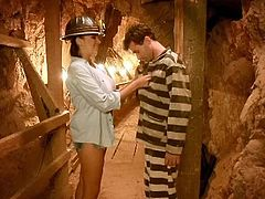 These guys are trying to escape and use that tunnel to do so, but their escape is delayed by this hot brunette. This babe is so hot, that she can make them stay! After they've entered the tunnel, the hottie shows her big hot breast, gets them groped and then, kneels for cock.