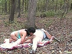 A slutty mature brunette is getting naughty with her man in the forest. She fingers her cunt ardently and then gives a blowjob to the dude and takes a ride on his wang.
