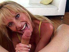 Hot cougar goes deep in wild POV oral along one large penis