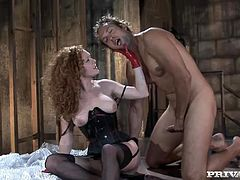 Slutty redhead dominatrix Audrey Hollander is having fun with some dude in a shed. She pleases him with a hot blowjob and then takes his dick into her butt and fucks the dude in cowgirl position.
