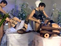 Two stunning girls in stockings and latex uniform have an amazing sex. They get fucked in their asses and pussies by big cocked guys.