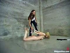 Slim blonde girl with nice boobs gets choked and then fingered by Kym Wilde. Later on Sadie also gets whipped achingly.