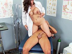 Busty doctor Alexis Breeze tells his patient to lie on the bed so she can check if everything is okay. She sucks his stiff cock in 69 position. Then she rides him in reverse cowgirl position.