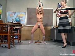 This lesbian BDSM session with lots of bondage and wicked sex toys goes on in a classroom. I bet the janitor wasn't around at the moment.