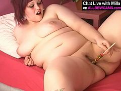 Playful BBW MILF is looking seductive as hell though she is extra plus size woman. She licks candy and sends the lollipop to her pussy hole. She pokes her cherry with sticky tasty candy solo masturbating on a bed.