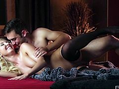 Luscious blonde babe with perky tits is wearing black nylon stocking while having steamy sex session. She is penetrated in her tight pussy hole from behind. Check out this arousing sex scene filmed by Babes studio