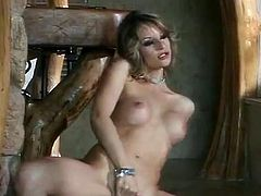 Sexy hottie Liz Honey is having fun with two dudes in the living room. She unties the guys and then sucks their schlongs before letting them double penetrate her.