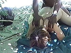 A horny black dude is having fun with some skank outdoors. They have passionate oral sex and then fuck in cowgirl and other positions on the ground.
