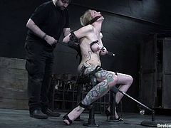 This amazingly sexy blond siren Rain DeGrey is so fucking amazing! She gets tied up with some bondage belts and then gagged in her mouth and in her delicious pussy!