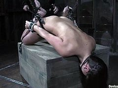 Sexy brunette gets tied up in dark wooden cabin. Then she gets her ass whipped and pussy toyed with a vibrator.