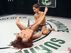 Isis Love is smaller than Shannon Kelly but she is more skillful fighter. So, she gets a win. That is why Shannon gets her vagina drilled with a strap-on and a vibrator right in a ring.