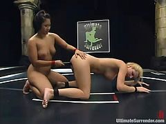 Two girls in bikini wrestle and then have wild lesbian sex right in a ring. Asian girl holds a victory in a fight. That is why she gets her pussy licked. After that the blonde girl gets toyed with big dildo.