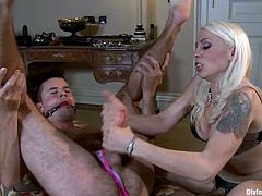 Blonde hottie Lorelei Lee and her pretty GF are having fun with some handsome guy. They play with his dick and torture the man and then slam his tight butt with a strapon.