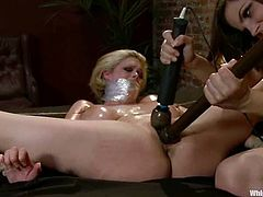 Slim brunette Bobbi Starr is playing BDSM games with chubby blonde Katie Kox. She ties Katie in the bedroom and rubs her cunt with a dildo before drilling it hard.