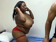 Ebony fatty getting fucked hard down her wet pussy. She surely is big but still hot in her red stockings. She will give your perverted side the attention it need with her huge tits bouncing up and down.