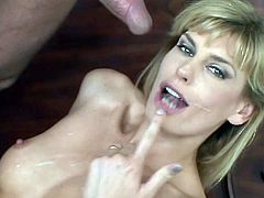 Get a load of this hardcore scene and watch this slutty blonde having her tight pussy drilled by this guy's big cock until her mouth's filled by cum as her man watches.