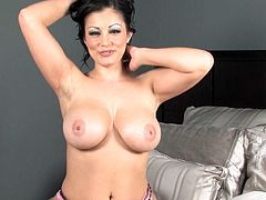 Alluring Aria Giovanni likes to impress by shaking her big tits while posing on cam