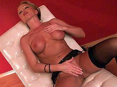 Naughty blonde MILF lies down on a lounge and massages her tits. Then she spreads the legs and starts to masturbate.