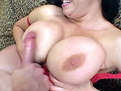 Horny cougar Angelica Sinn flaunts her big natural tits on camera for your visual pleasure. Her lover rubs his hard cock in between those boobs and ends up fucking her tight ass hard and deep.