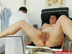 Chubby old bitch takes her clothes off and gets examined by a doctor. After some time she gets her vagina toyed with a dildo.