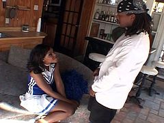 After blowing her man's cock, this slender ebony cheerleader reaches a huge orgasm. Watch her getting her tight cum blasted deep and hard into a massive explosion of pleasure.