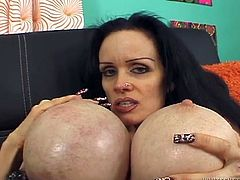 Mature brunette mommy looks pretty much like alien. At least this concerns to her balloons. This woman apparently doesn't know when enough is enough. She has pumped her boobs with silicon to enormous size. Watch this ugly woman caressing her hairy pussy before giving a head.