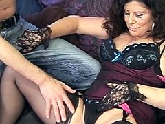 Brunette milf in black lingerie gets stretched in hardcore by hunk with massive dick