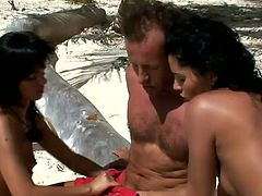 Two gorgeous brunettes Black Angelika and Lucy Belle are playing dirty games with some man on a beach. They favour him with a fantastic blowjob and then get their vags and asses fucked deep and hard.