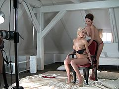 Beautiful lesbians Lena Love and Eve F are having fun in a studio. They caress and kiss each other and then lie down on the floor and please each other with cunnilingus.