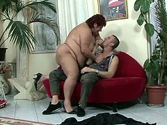 This obese mature has some alone time with her really fat cunt. Then, this young stud comes to the rescue, fucking her huge cunt from behind and cumming in her mouth.