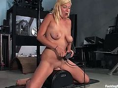 Kinky blonde Lacey Jane doesn't mind to get her vag pounded by a fucking machine. She rubs her nice cunt and then gets it drilled hard by the device.