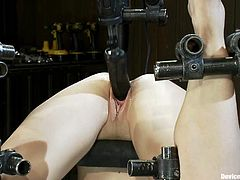 Hot slut Dylan Ryan gets chained and hung head over heels in a basement. Then some guy attaches weights to the bitch's tits and slams her snatch with the help of a fucking machine.