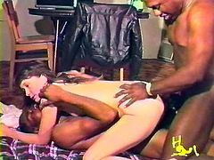 A lustful brunette is getting naughty with two black guys in MMF interracial scene. The men fuck the bitch's mouth and then double penetrate her on the bed.