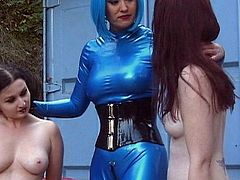 Sluts in leather costumes are having nasty pleasures during their hot outdoor threesome femdom
