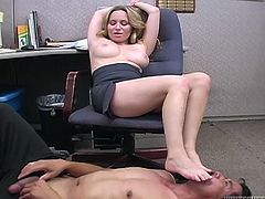 This sex-starved bimbo with big tits is very confident in her own power of seduction. She makes horny janitor lick her armits. Then she lets him worship her feet.
