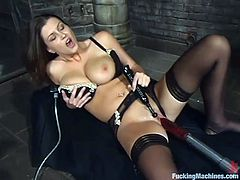 Well-endowed brunette Sara Stone is having fun in a basement. She strokes her terrific natural tits and gets her juicy cunt pounded by a fucking machine.
