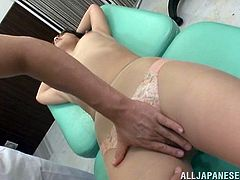 This hot Japanese girl has fun at a medical examination. She gets oiled up by a doctor and then fingered. In addition she also gets toyed with a vibrator.