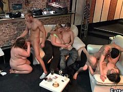 Well, this is what our bar is really famous for. Every party and get-together we have, they all end in BBW fucking mayhem. Just look! The couple who have been taking it slow, despite all what's been going on around them, are in the spotlight now. She's slurping on his raging boner and he pays the fat beauty back with some of the most intense dick stabbing you can ever hope to witness. After that, it's all one big sexy mess. Don't miss the first guy to get lucky play with a girl's massive rack whie his friend is pounding away at her tight twat doggy style!